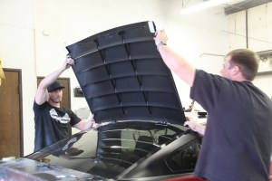 23.You need a buddy to help set the louvers to the car. The edges of the louvers get lined with a little foam tape to protect it from scratching the glass.