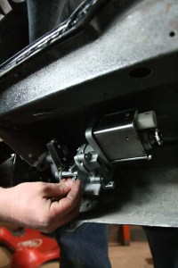 16. Next, we mounted the motor to the assembly. Don't forget the catch pin on the locator bar.