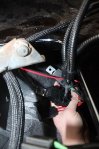 25. The relays for the Painless Performance harness were mounted to the inner fenderwell behind the nose of the car. There are two relays and a fuse holder. The harness uses one of the factory headlamp plugs for the trigger, and you need to run a wire to the battery. This part takes about 15 minutes.