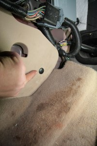 16. The driver panel has a tree lock in the back holding it in; remove and save this plug, you will need it.