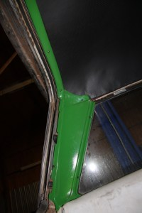 25. The freshly powder coated trim was reinstalled around the perimeter of the headliner. As you can see here, the rear trim is quite convoluted; there are 4 separate pieces here.