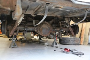 1. As with any under-vehicle work, the car was raised and supported with jack stands. Never work under a vehicle without jack stands on a stable surface. The wheels were removed from the rear end. You will notice that the fuel tank is also out; this is not necessary and was part of another project.