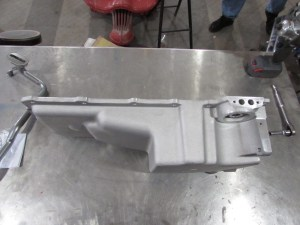 """30. The Holley 302-2 oil pan has increased clearance for GM f-body chassis; it will also work well in A-body (64-72) frames. The 302-1 pan has a deeper front sump and does not clear the A-body steering when the engine is in the stock SBC location. It will work if the engine is raised up about a ½""""."""