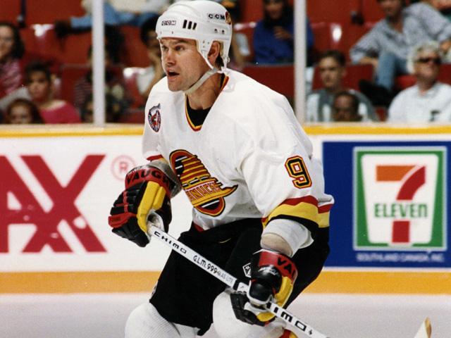 Ryan Walters playing hockey