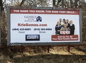 There is too much going on in this billboard. If someone where driving past it, they wouldn't know which number to write down. Also the font is too small. They have 2 logos and their tagline at the top gets lost.
