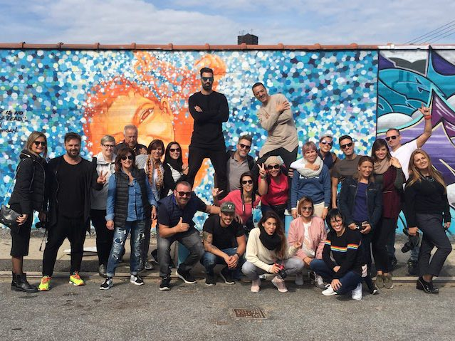 tour group in front of street art mural