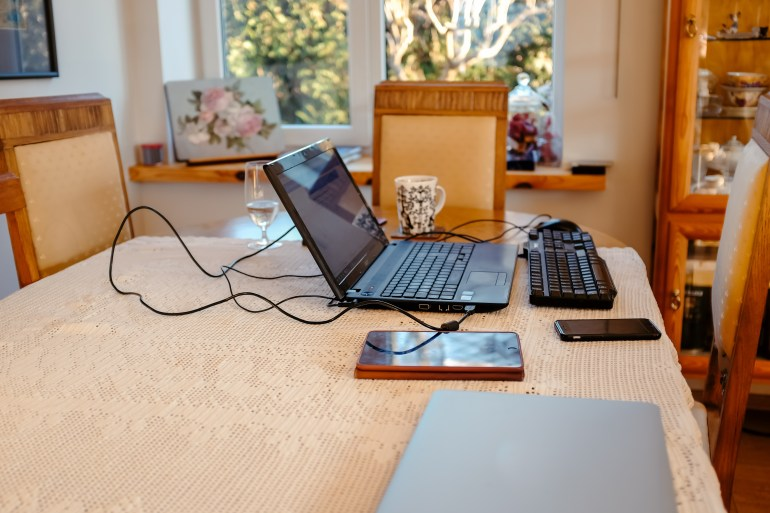 Computer And Devices On A Table In A Living Room