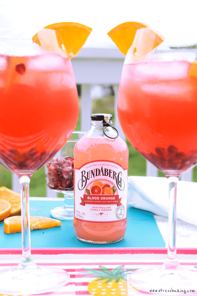 Blood Orange Sangria with Bundaberg Sparkling Beverages: A beautifully vibrant and delightfully fruity sangria made easy with Bundaberg Blood Orange Brewed Drink! Must be 21+ to enjoy. | stressbaking.com #ad