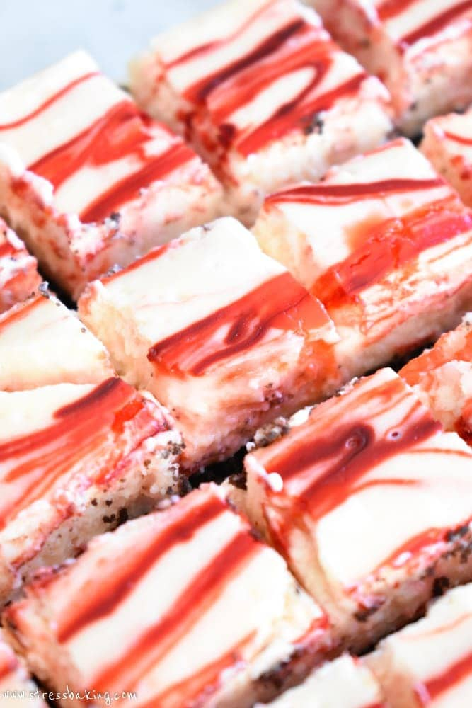 Peppermint Bark Cheesecake Bites: A chocolate cookie crust is topped with creamy and rich peppermint cheesecake, loaded with white chocolate peppermint pieces, crushed candy canes and topped off with more chocolate. Holiday dessert perfection! | stressbaking.com