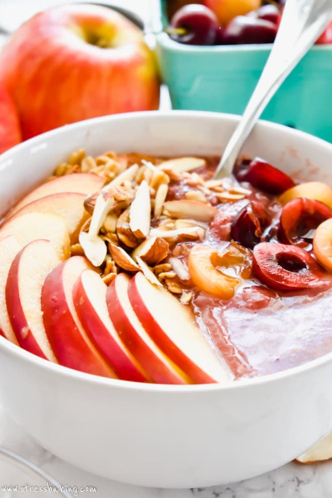 Apple Cheery Smoothie Bowl on a table with fresh fruit