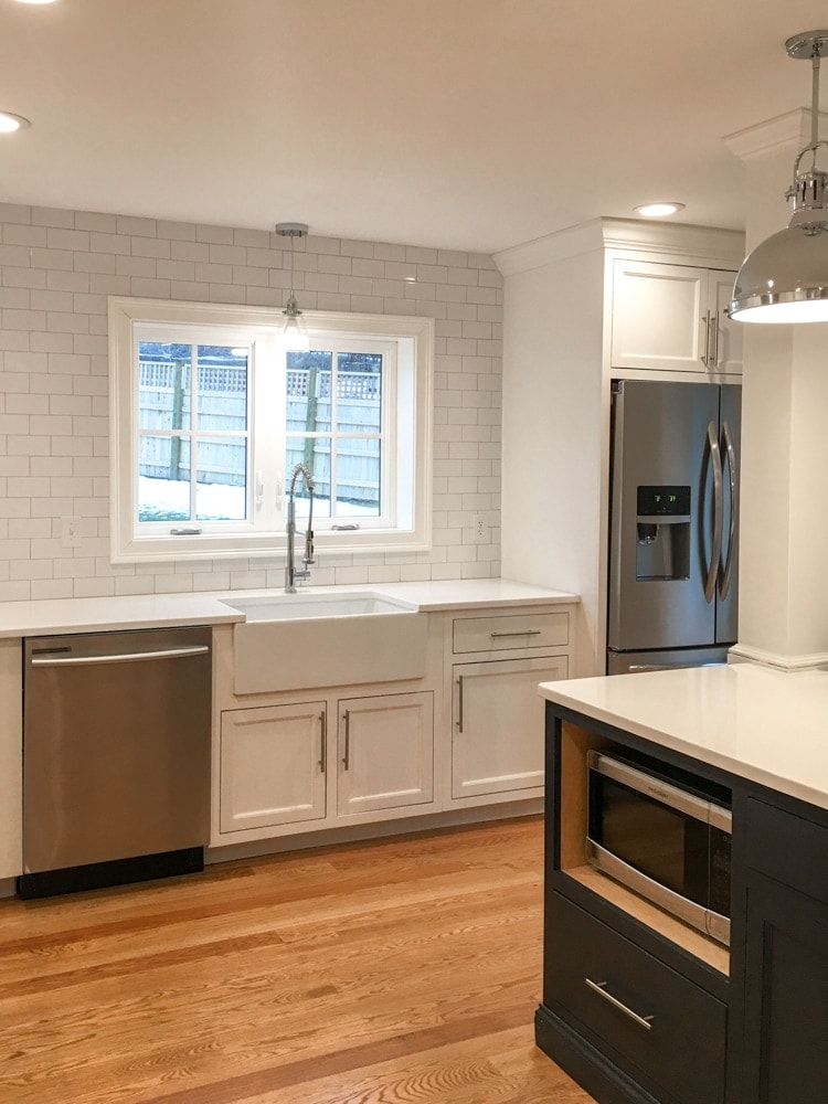 Kitchen with white subway tile and farmhouse sink