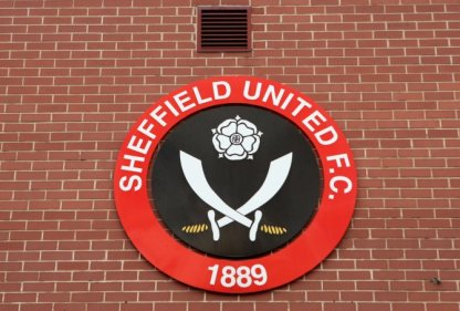 Club logo on the wall outside of Bramall Lane