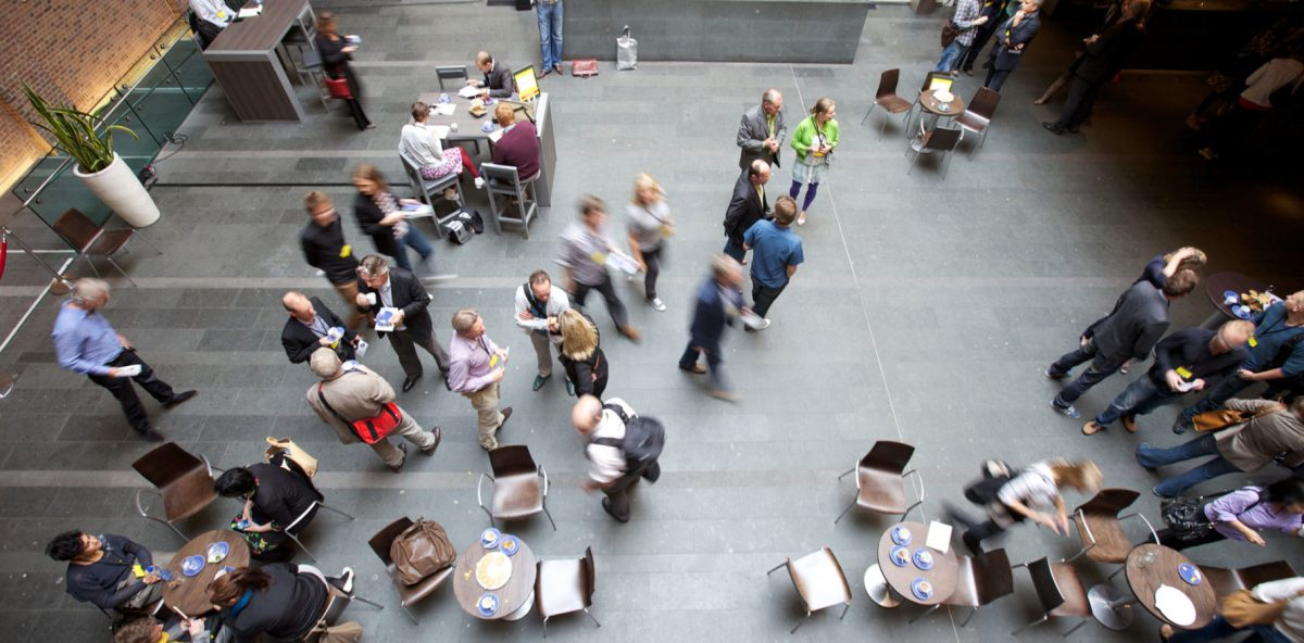 A large space in a cafe style layout. People mill around.