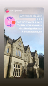 """An Instagram post. The image is of Hawkwood, a country house. The imposing house is in the gothic style, with plants creeping up its aged but well-presented facade. Its image is captured before a blue sky. Above is the text """"A week of making art but now over and out. Thank you so much @strikealightfestival & @hawkwood_cft"""""""
