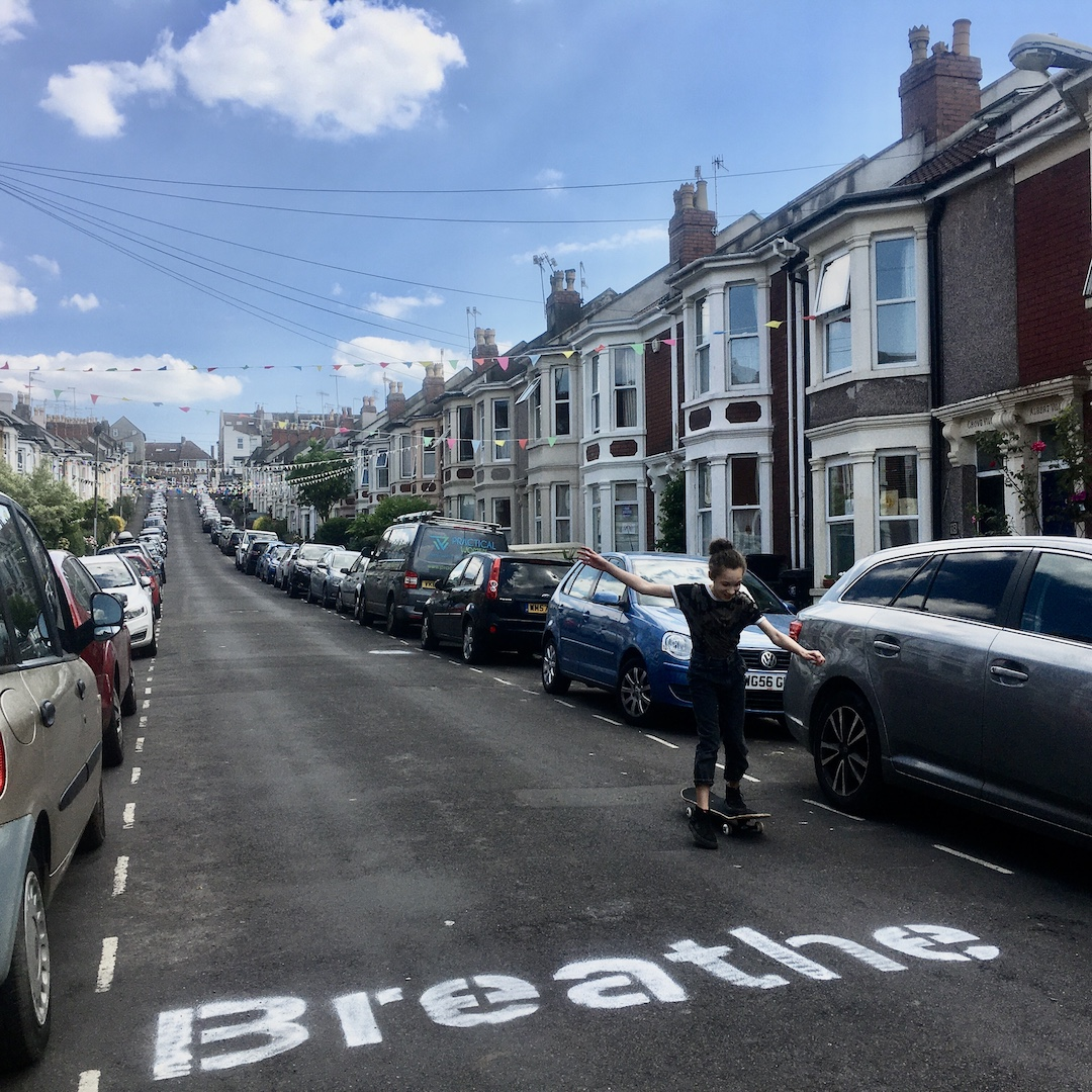 The word 'breathe' spraypainted on to a street in large letters