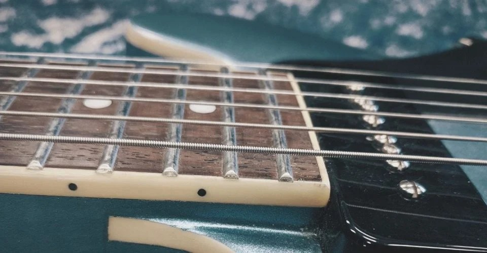 Guitar Action: The Complete Guide