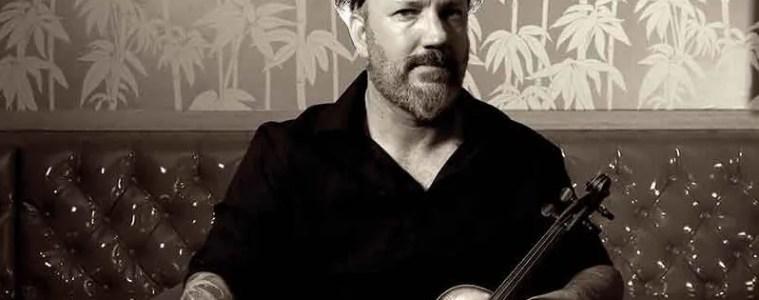 Violinist David Bragger with his fiddle