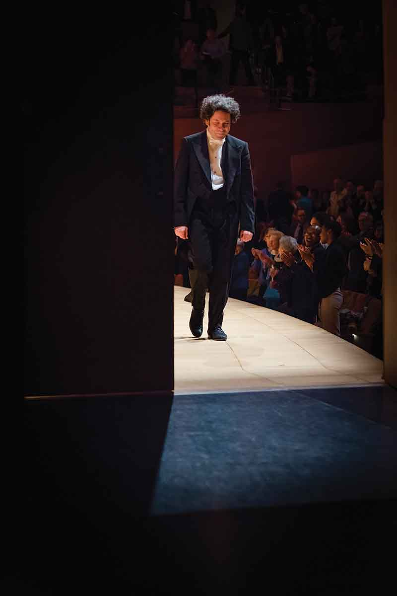 Los Angeles Philharmonic music director Gustavo Dudamel exits the stage