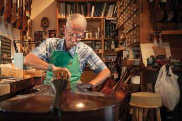 Luthier Hans Benning works at Benning Violins, one of L.A.'s celebrated shops