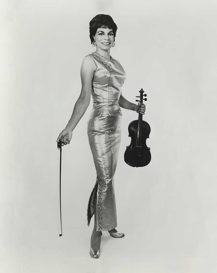 jazz violinist Ginger Smock posing with violin in a dress