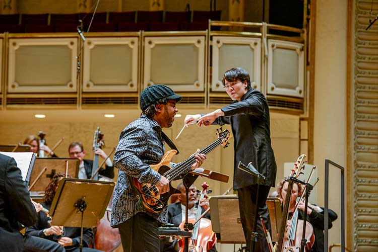 Victor Wooten playing electric bass with the Chicago Sinfonietta
