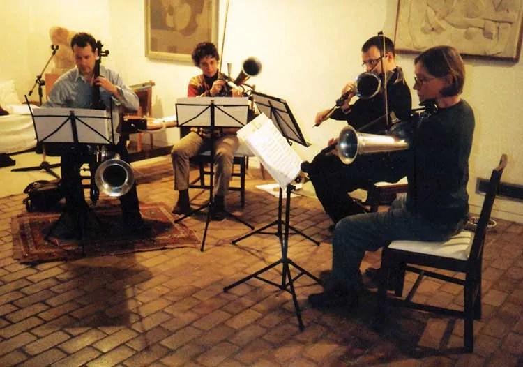 a quartet of musicians play stroh violins