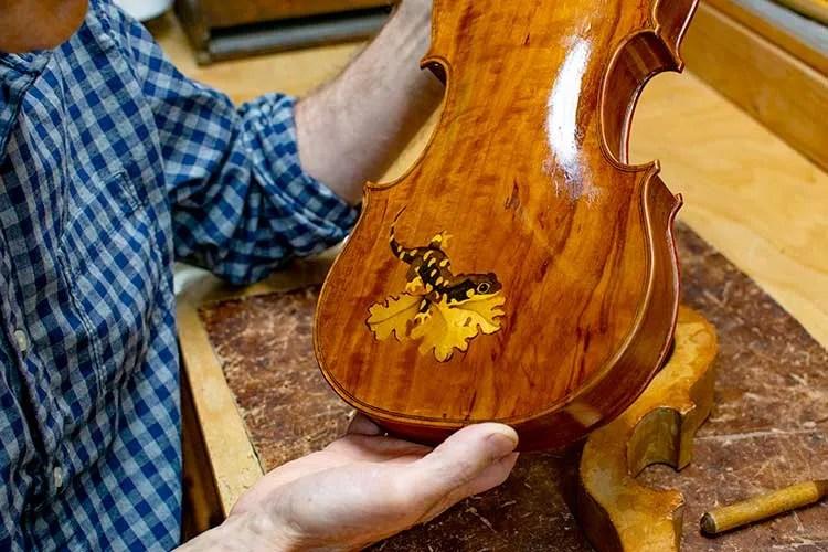 The finished salamander inlay on violin back