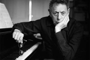 Philip Glass at piano black and white portrait
