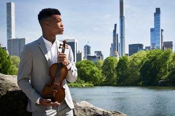 Violinist Randall Goosby against a New York backdrop