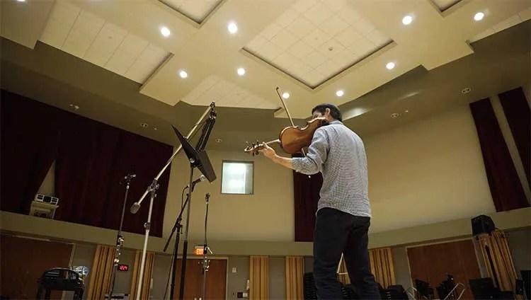 Masumi Rostad playing violin in recording studio