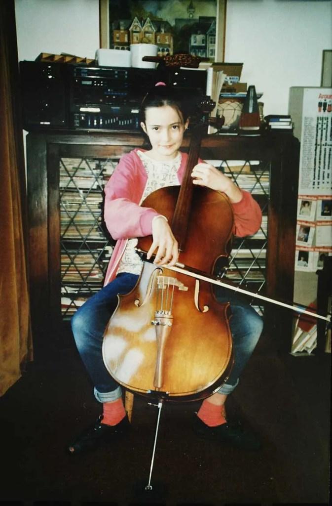 Cellist Miranda Wilson at age 9 with 1/2-size cello