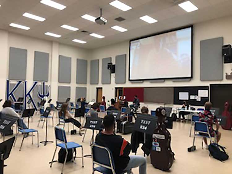 String students attend a socially distanced class, Photo: courtesy of Texas State University School of Music