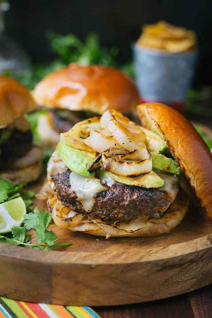 Cuban mojo beef burgers with grilled onions and avocado