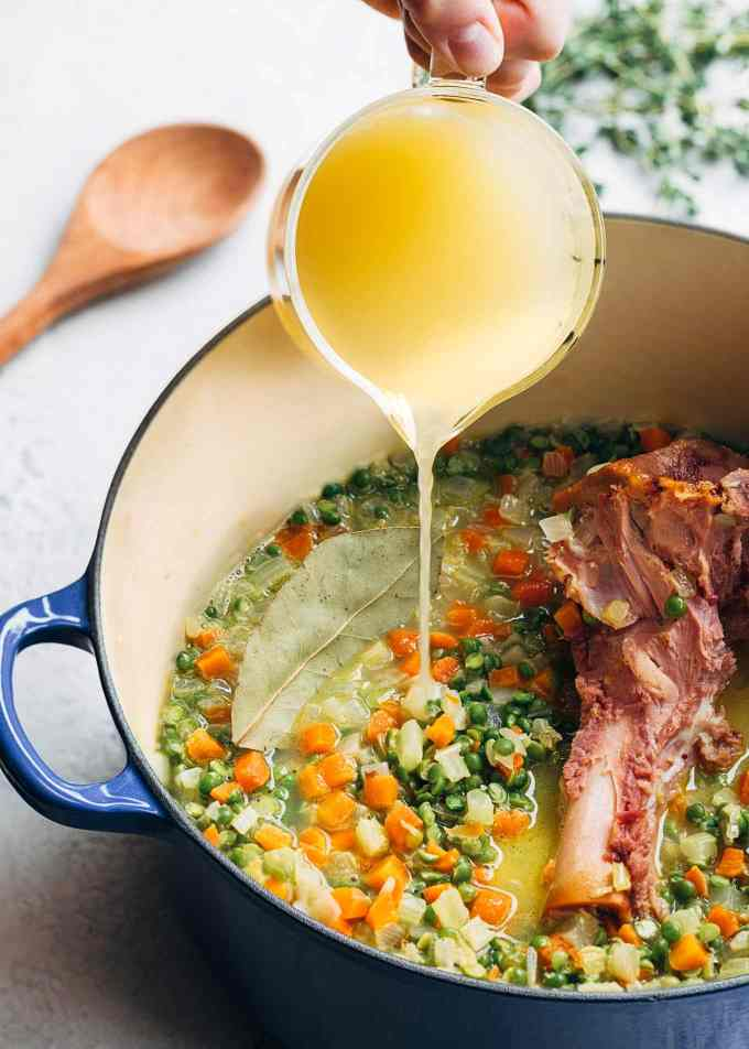 adding chicken stock to split pea soup with ham bone