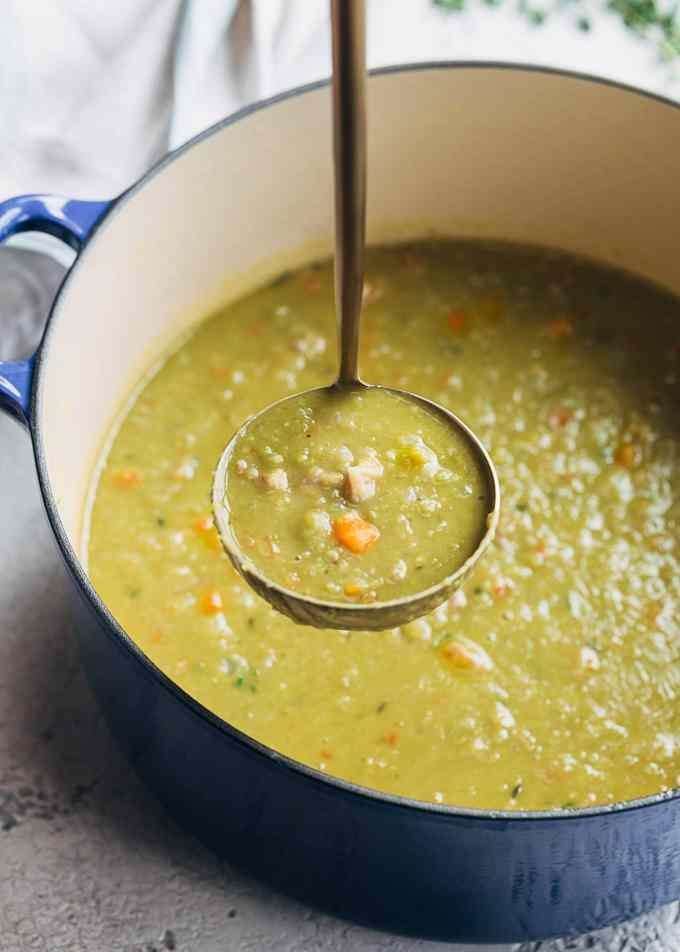 ladle of split pea soup and ham