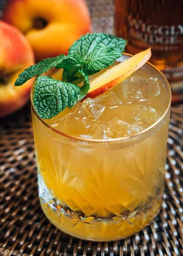 bourbon peach smash cocktail with mint
