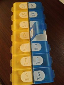 Daily pill organizer with one door open