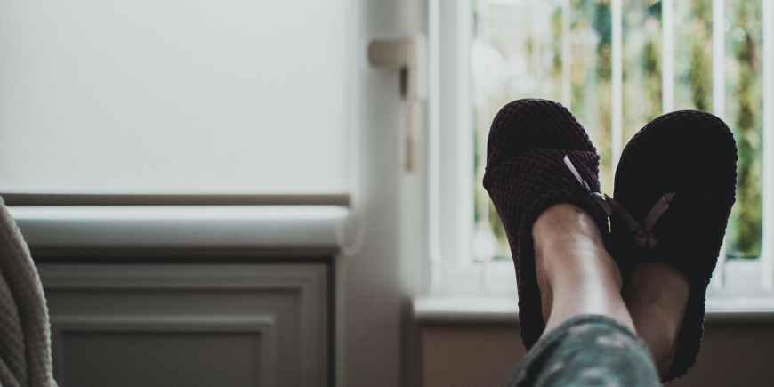 person wearing pair of black slides