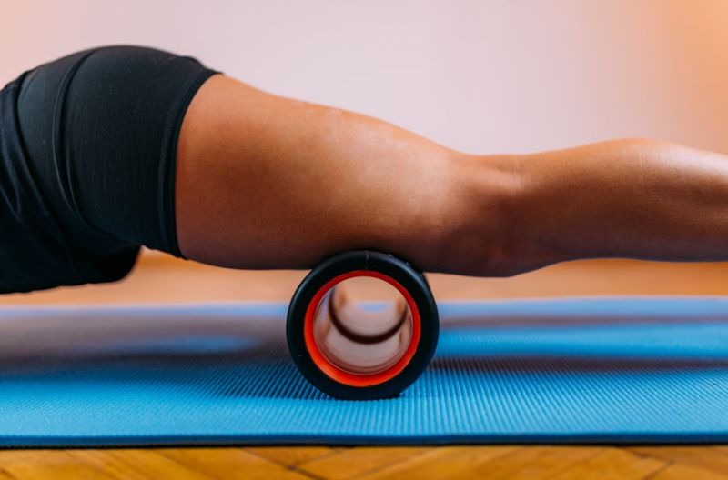 rolling thighs on a foam roller