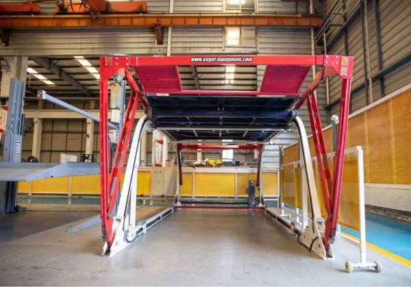 Red, white and black car lift.