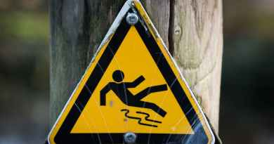 sign slippery wet caution