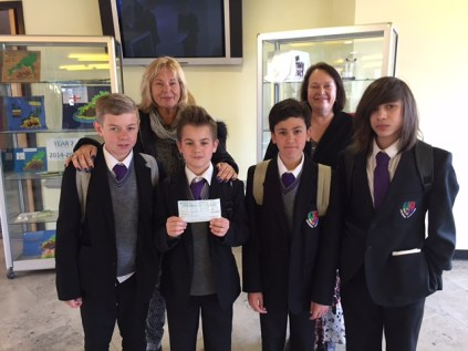 Woodys Woodwork donating to Cancer Research's Andie Fuller and Mrs Bolt - Headteacher