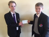 Travis Bourgaize and Leighton Woodhead donating to Cancer Research