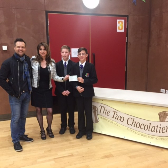 Andy and Jo Priaulx with The Two Chocolatiers donating to the Priaulx Baby Care Foundation