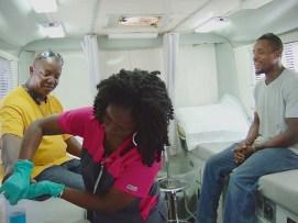 Henry James and Jean Washington prepare to donate blood with Nurse Latoya Martinez.
