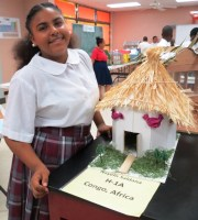 Living in the Congo. Nayellis Saldana shows off the green home she created as part of a Homes for Humanity project.
