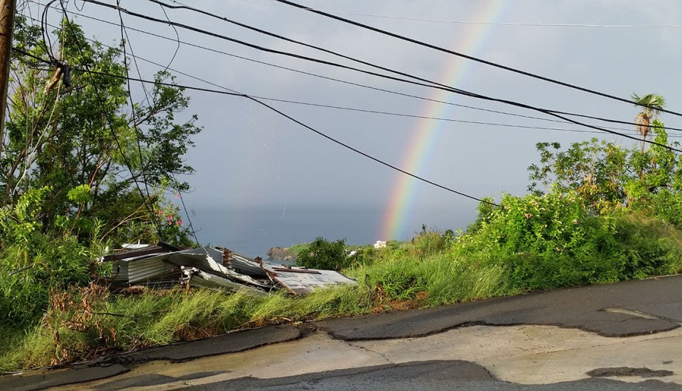 Debris, downed utility lines and a double rainbow over Hull Bay. (SAP photo)