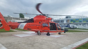 An MH-65 Dolphin helicopter from Coast Guard Air Station Borinquen medivaced a patient from Celebrity Reflection to a hospital in San Juan. (Coast Guard photo)