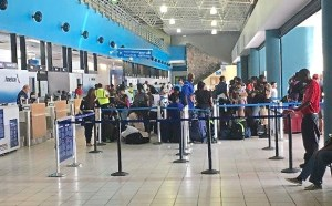 Passengers crowd into the Cyril E. King Airport (V.I. Port Authority photo)