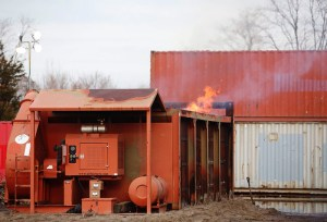 """An air curtain incinerator in use at Floyd Bennet Field, Brooklyn, New York, after Hurricane Sandy. (Image from """"Notice of Intent to File Suit"""" from the Environmental and Natural Resources Law Clinic at Vermont Law School.)"""